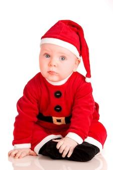 Bebê na fantasia de papai noel no natal