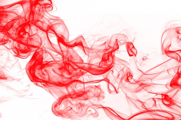Bela arte de fumaça vermelha abstact sobre fundo branco, cor de água de tinta