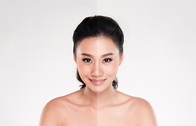 Bela jovem asiática no fundo branco