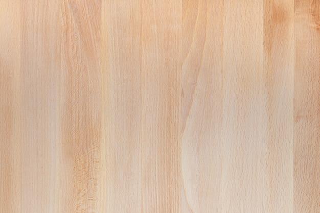 Bela textura da mesa de madeira na cor natural. vista de cima. lamas na direção vertical. espaço para inserir seu próprio texto aqui.