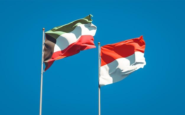 Belas bandeiras de estados nacionais do kuwait e da indonésia juntas no céu azul