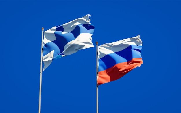 Belas bandeiras do estado nacional da finlândia e da rússia juntos no céu azul. arte 3d