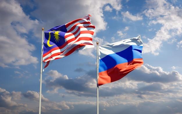 Belas bandeiras do estado nacional da malásia e da rússia juntos no céu azul. arte 3d