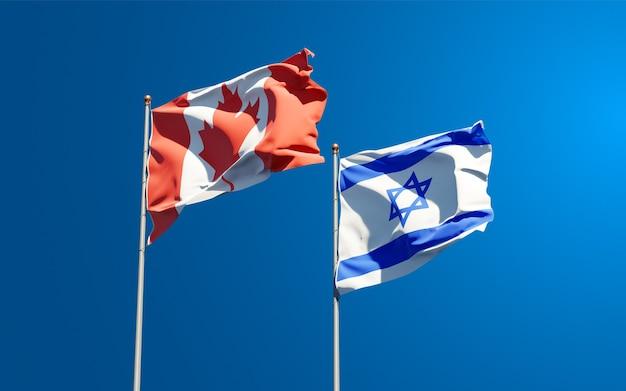 Belas bandeiras do estado nacional de israel e canadá juntos ao fundo do céu.