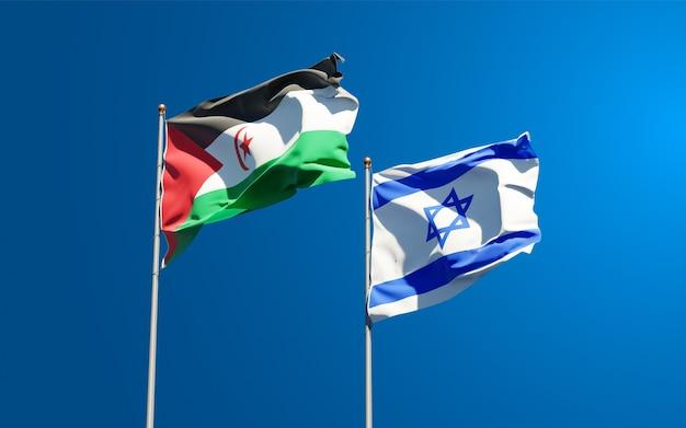 Belas bandeiras do estado nacional de israel e sahrawi juntos ao fundo do céu.