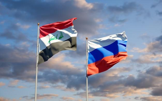 Belas bandeiras do estado nacional do iraque e da rússia juntos no céu azul. arte 3d