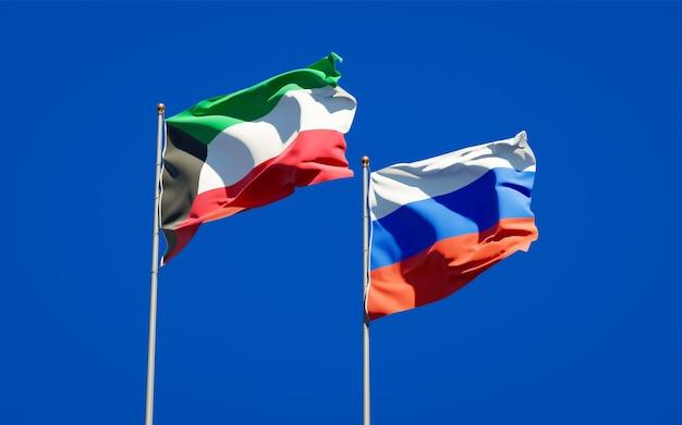 Belas bandeiras do estado nacional do kuwait e da rússia juntos no céu azul. arte 3d