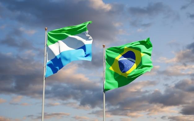 Belas bandeiras dos estados de serra leoa e brasil juntas no céu azul