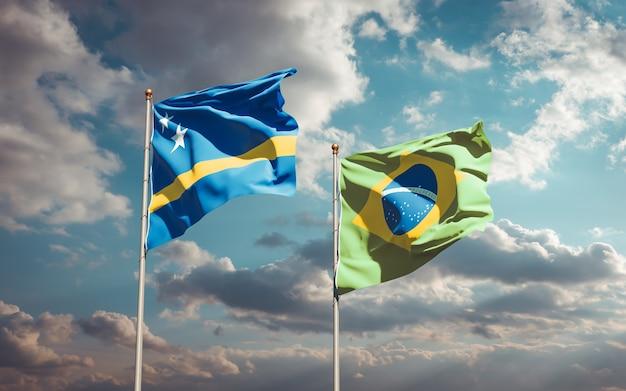 Belas bandeiras dos estados do brasil e curaçao juntas no céu azul