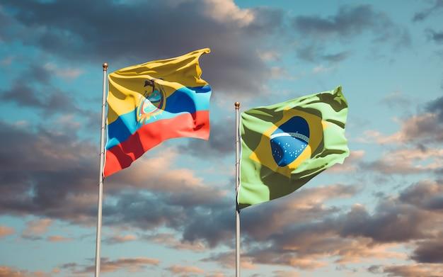 Belas bandeiras dos estados nacionais do equador e do brasil juntas no céu azul