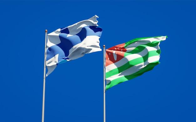 Belas bandeiras estaduais da finlândia e da abkházia juntas