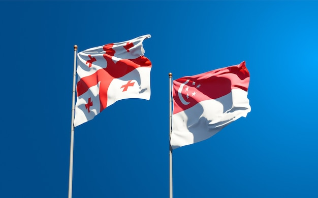 Belas bandeiras estaduais da geórgia e cingapura juntas