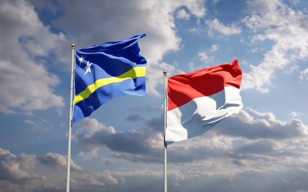 Belas bandeiras estaduais da indonésia e curaçao juntas no céu azul