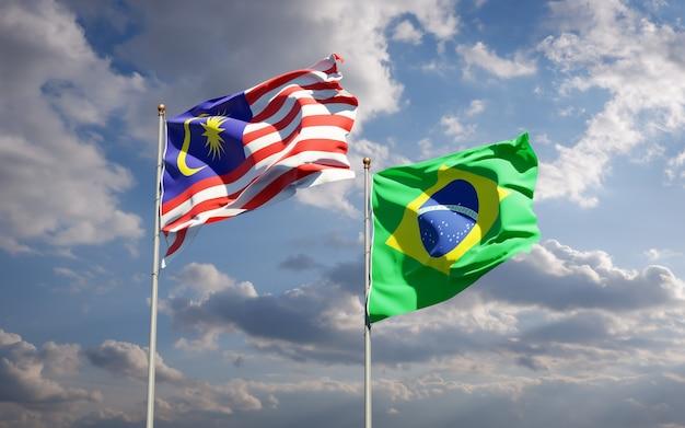 Belas bandeiras estaduais da malásia e do brasil juntas no céu azul