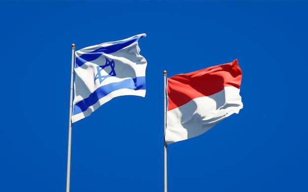 Belas bandeiras estaduais de israel e indonésia juntas no céu azul