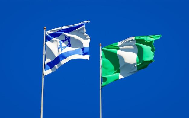 Belas bandeiras estaduais de israel e nigéria juntas no céu azul