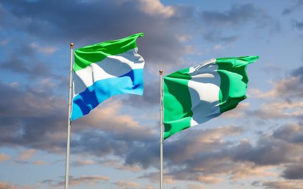 Belas bandeiras estaduais de serra leoa e nigéria juntas no céu azul