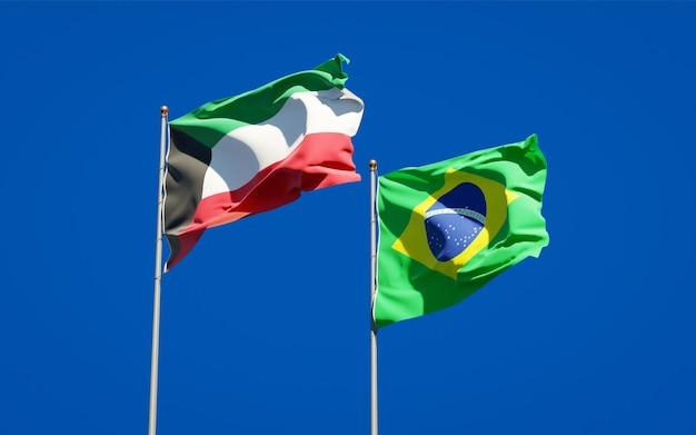 Belas bandeiras estaduais do kuwait e do brasil juntas no céu azul