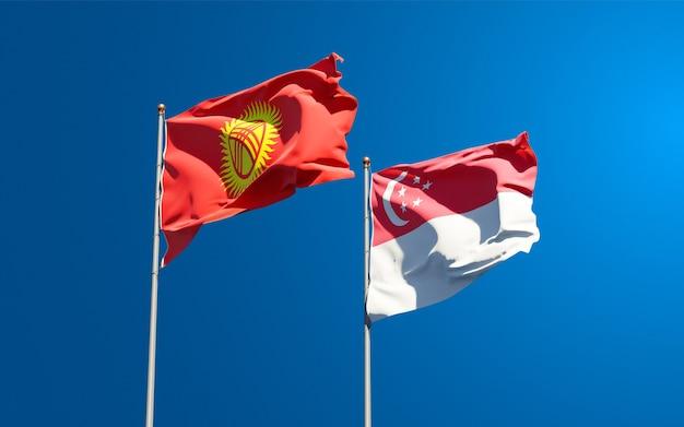 Belas bandeiras estaduais do quirguistão e cingapura juntas