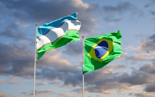 Belas bandeiras estaduais do uzbequistão e do brasil juntas no céu azul