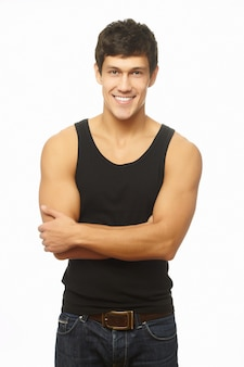 Bem sucedido jovem musculoso sorrindo