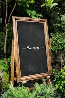 Bem-vindo maquete de placa de frame de madeira