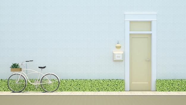 Bicicleta e porta amarela no fundo de tijolo branco