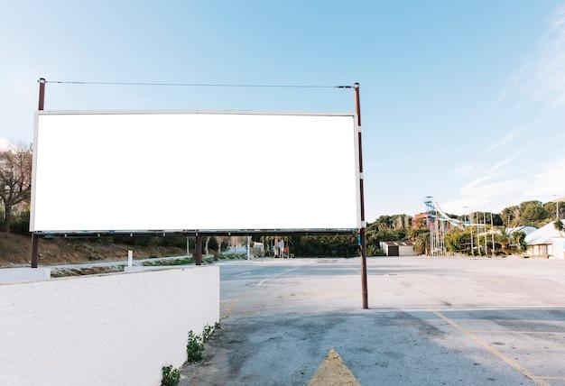 Big white billboard on city parking