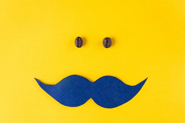 Bigode azul e grãos de café para o conceito movember