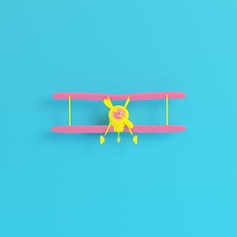 Biplano amarelo em fundo azul brilhante