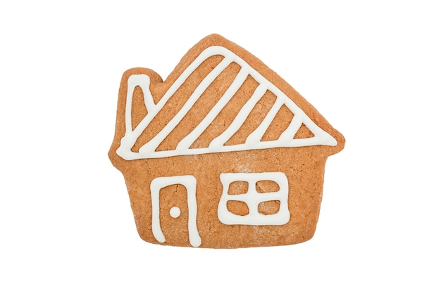 Biscoito de gengibre da casa de natal isolado em um fundo branco