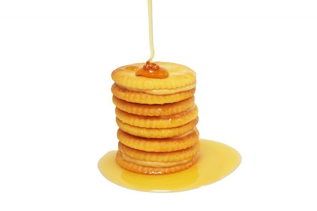 Biscoitos de mel de caramelo cobertos com comida saborosa de sobremesa doce mel em branco Foto Premium