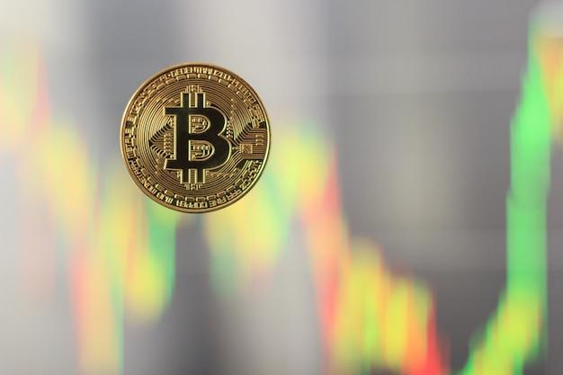 Bitcoin com um gráfico borrado no fundo, o conceito de subida e descida dos preços