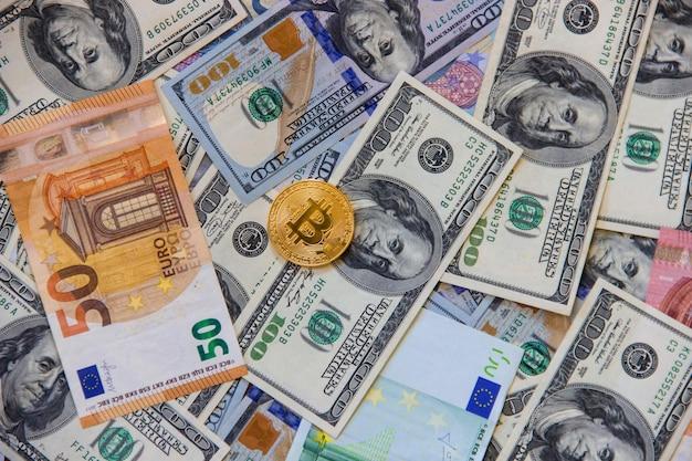Bitcoin dólares e euros. foco seletivo.