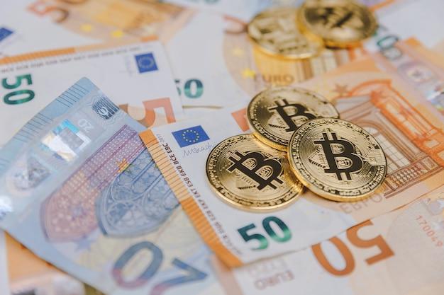 Bitcoins e euros, dinheiro e moeda conceito de taxa de câmbio
