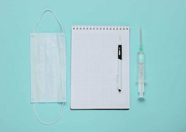 Bloco de notas com suprimentos médicos em azul