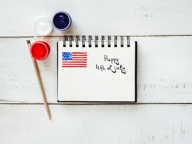 Bloco de notas com uma foto da bandeira dos eua
