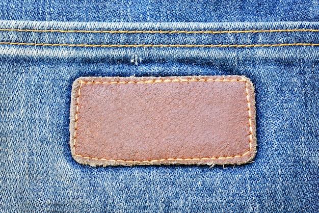Blue jeans texture denim com lather tag fundo padrão