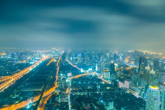 Bokeh abstrata borrada de luzes do fundo da paisagem urbana
