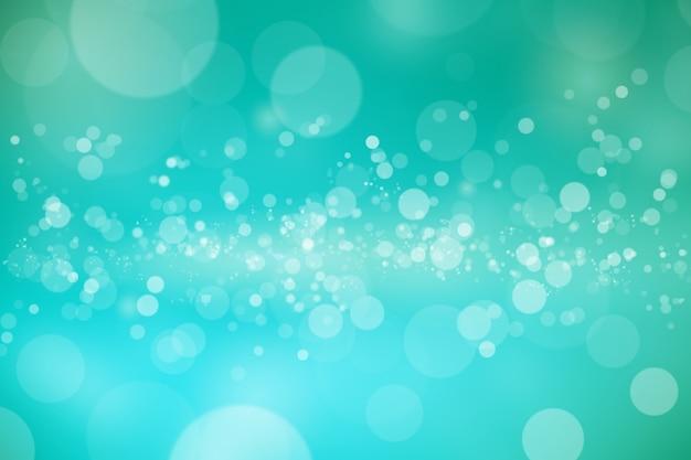 Bokeh brilhante abstrato sobre fundo desfocado verde esmeralda.