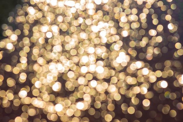 Bokeh brilhante sobre um fundo escuro. fundo brilhante e festivo_
