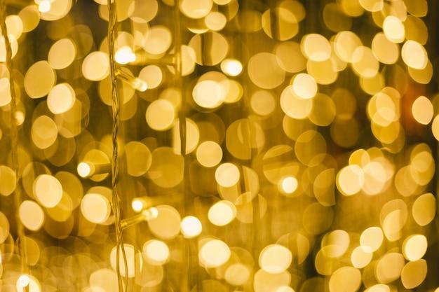 Bokeh circular abstrato claro colorido do natal e do fundo do ano novo feliz.