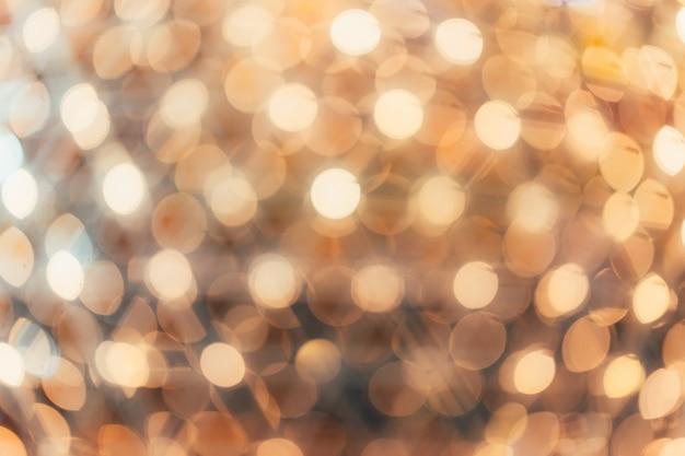 Bokeh da iluminação na luz suave bonita do teste padrão do partido da noite.