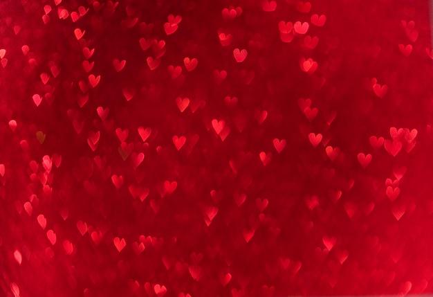 Bokeh de corações vermelhos. fundo de amor dia dos namorados