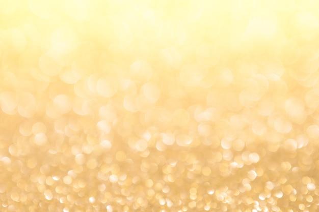 Bokeh de luz de fundo abstrato ouro natal feriado