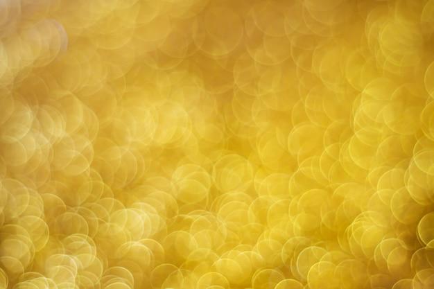 Bokeh de luz ouro abstrato luz de natal turva fundo