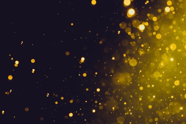 Bokeh de ouro abstrata em fundo preto