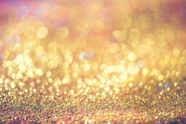 Bokeh de ouro brilho colorfull turva abstrato para aniversário, aniversário, casamento