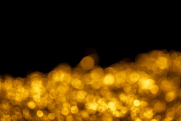 Bokeh de ouro sobre fundo preto