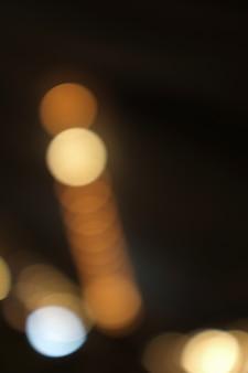 Bokeh dourado luz abstrata, fundo laranja